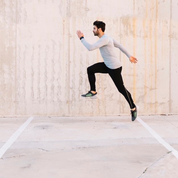 Handsome man leaping during training Free Photo