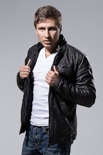 Handsome man in leather jacket Free Photo