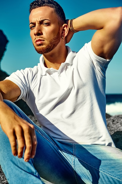 Handsome man model in hipster summer clothes Free Photo