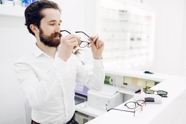 Handsome man in a optics shop Free Photo