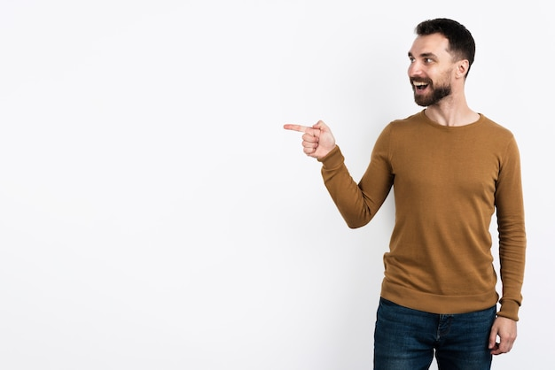 Handsome man pointing and posing surprised Free Photo