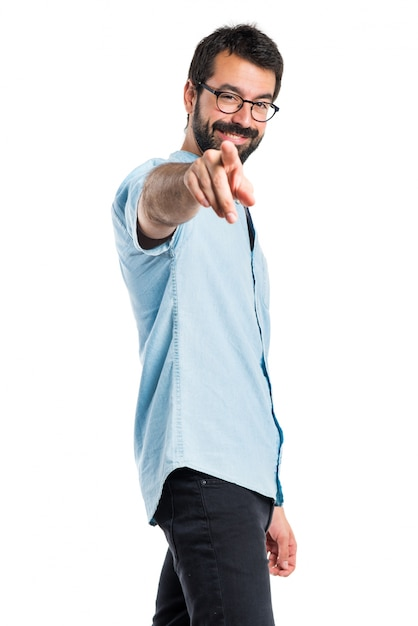 Handsome man pointing to the front Free Photo