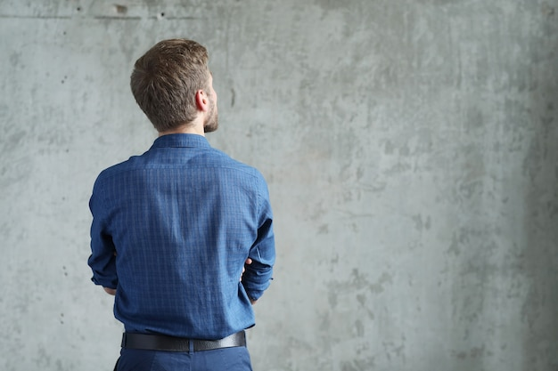 Handsome man posing, back view Free Photo