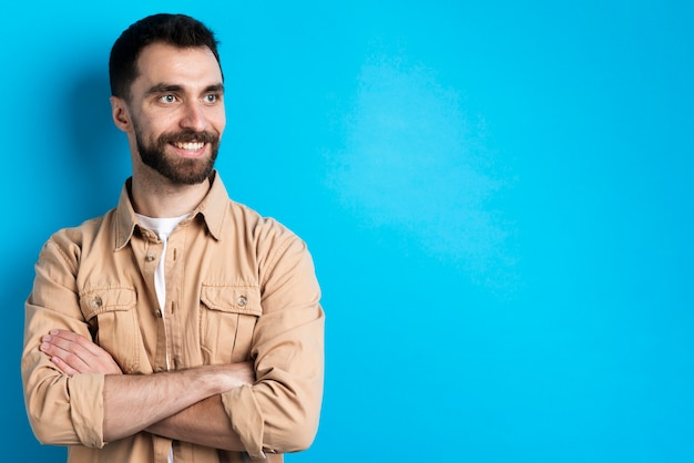 Handsome man posing with crossed arms Free Photo