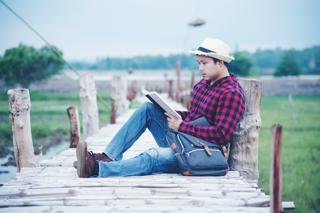 Handsome man relax in the travel nature Free Photo
