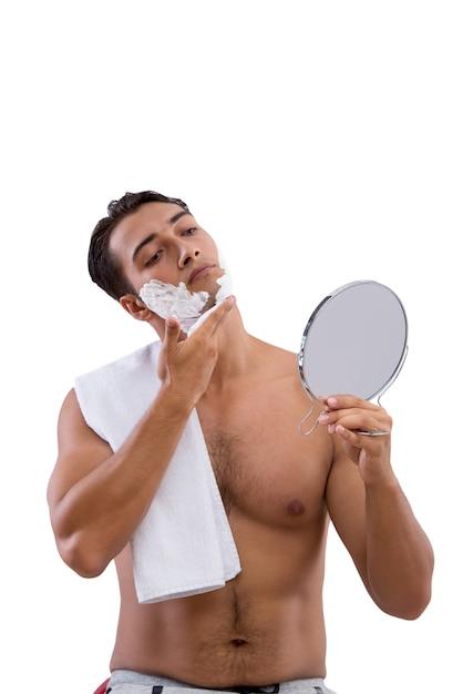 Handsome man shaving isolated on white Premium Photo
