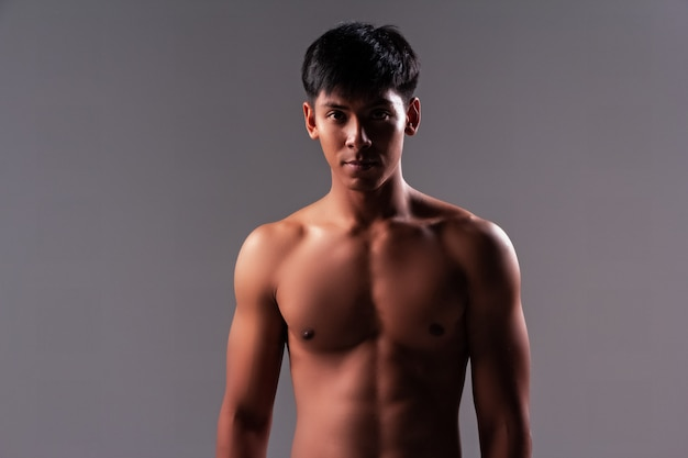 The handsome man show body muscle Premium Photo