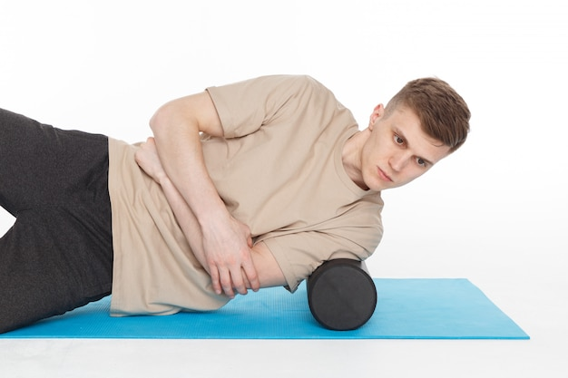 Handsome man shows exercises Premium Photo