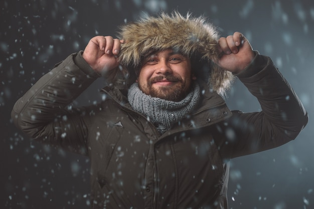 Handsome man in snow storm Free Photo