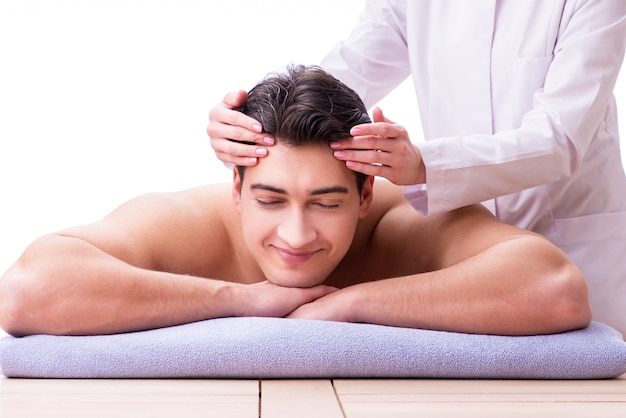Handsome man in spa massage concept Premium Photo