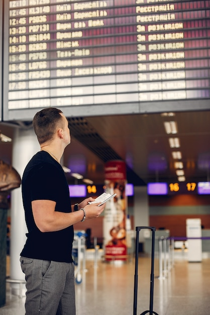 Handsome man standing in airport Free Photo