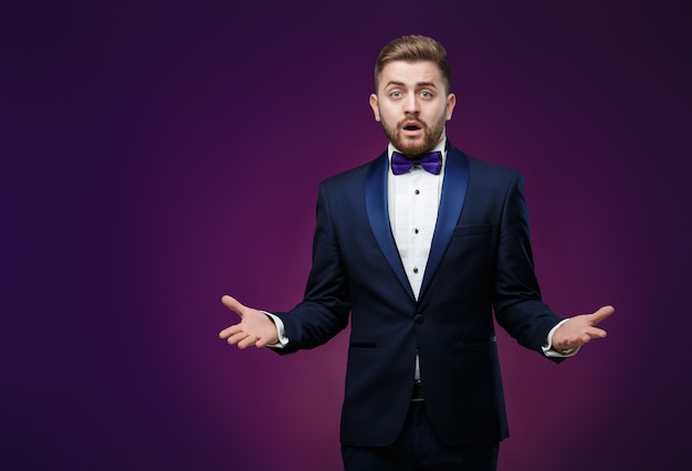 Handsome man in tuxedo and bow tie Premium Photo