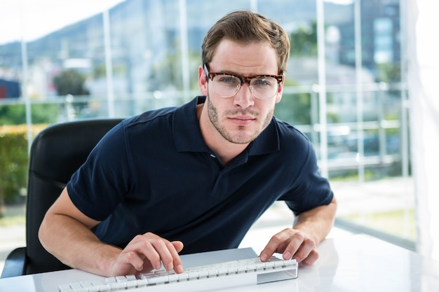 Handsome man using computer in the office Premium Photo