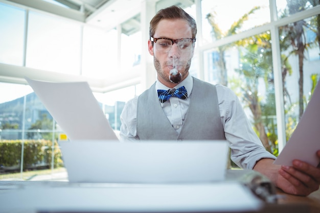 Handsome man using old fashioned typewriter in bright office Premium Photo