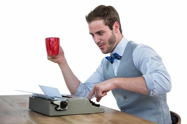 Handsome man using old fashioned typewriter Premium Photo