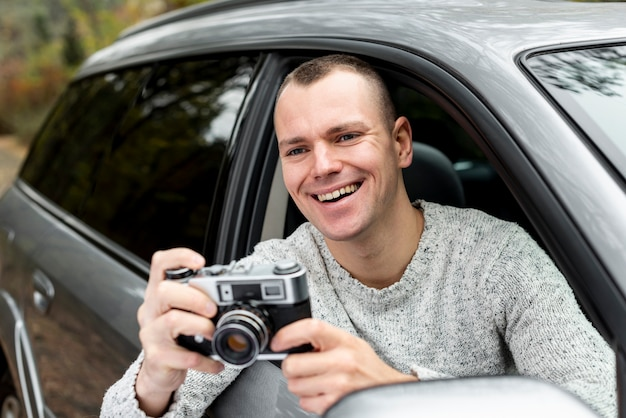Handsome man using a vintage camera Free Photo