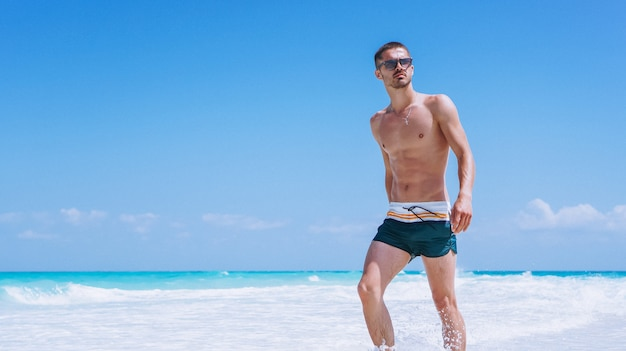 Handsome man on a vacation by the ocean Free Photo