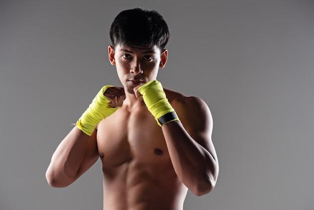 The handsome man wearing yellow mitt, raise hands up and fist Premium Photo