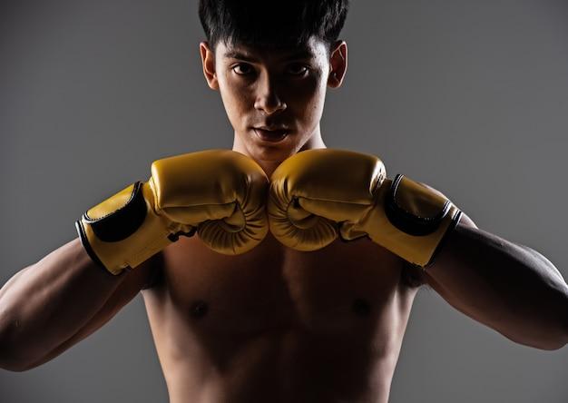 The handsome man wearing yellow mitt Premium Photo