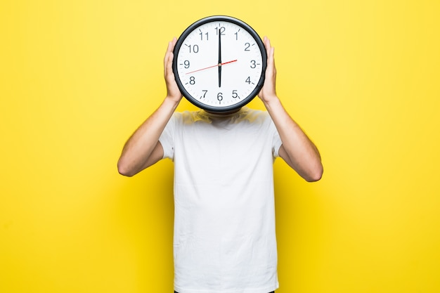 Handsome man in white t-shirt and transperent glasses hold big clock in place of his head Free Photo