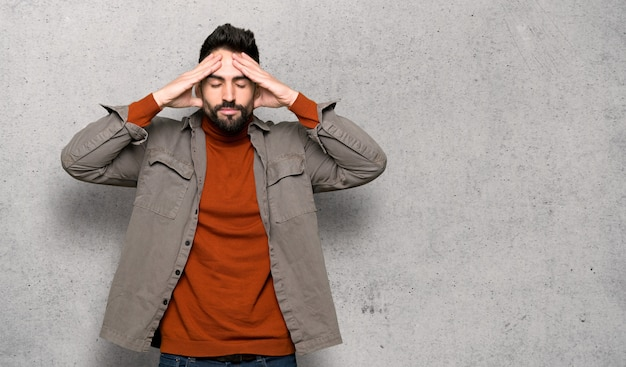 Handsome man with beard unhappy and frustrated with something over textured wall Premium Photo