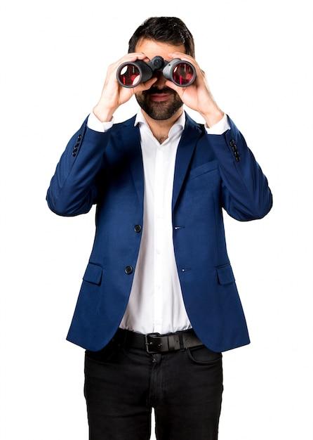 Handsome man with binoculars Free Photo