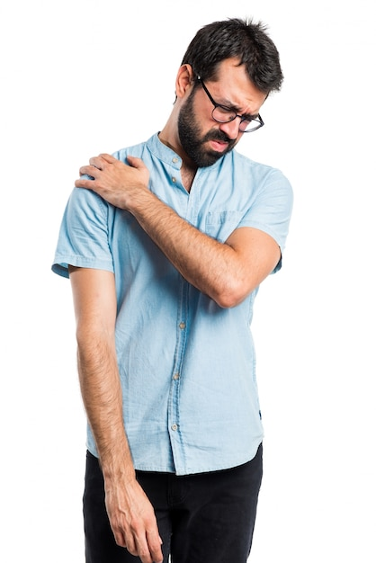 Handsome man with blue glasses with shoulder pain Free Photo