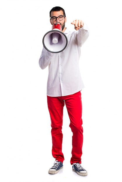 Handsome man with glasses shouting by megaphone Free Photo