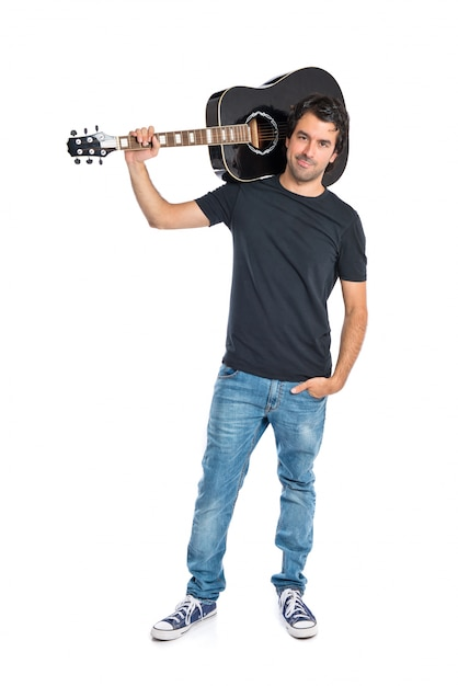 Handsome man with guitar over white background Free Photo