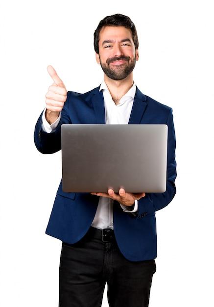 Красивый человек с ноутбуком Бесплатные Фотографии