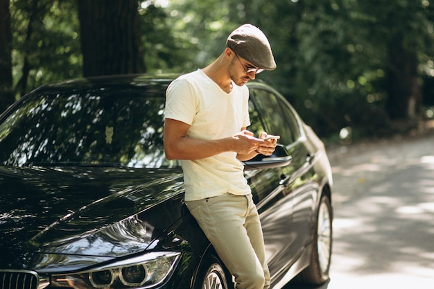 Handsome man with phone by car 1303 9829