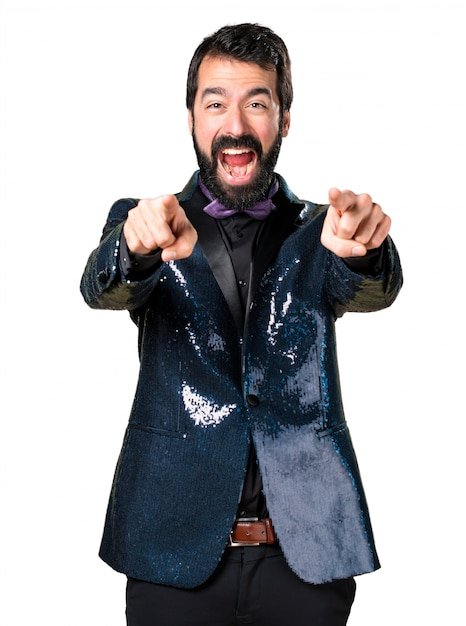 Handsome man with sequin jacket pointing to the front Free Photo