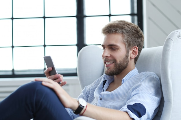 Handsome man with smartphone Free Photo