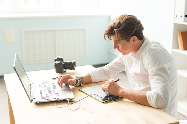 Handsome man working with graphic tablet Premium Photo