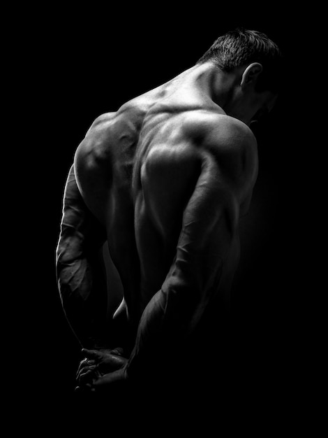 Handsome muscular bodybuilder turned back Premium Photo