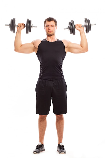 Handsome muscular guy working out Free Photo
