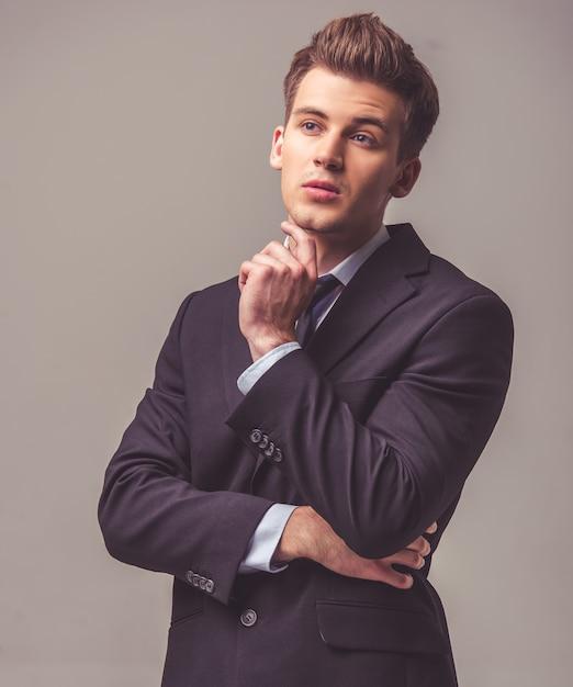 Handsome pensive businessman in suit is looking away. Premium Photo