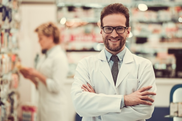Handsome pharmacists working in pharmacy. Premium Photo