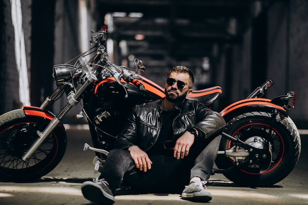 Handsome sexy man on motorbike Free Photo