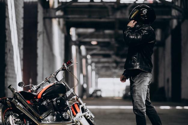 Handsome sexy man on motorbike Free Photo