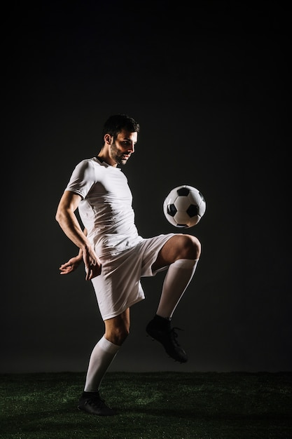 Handsome sportsman juggling ball Free Photo