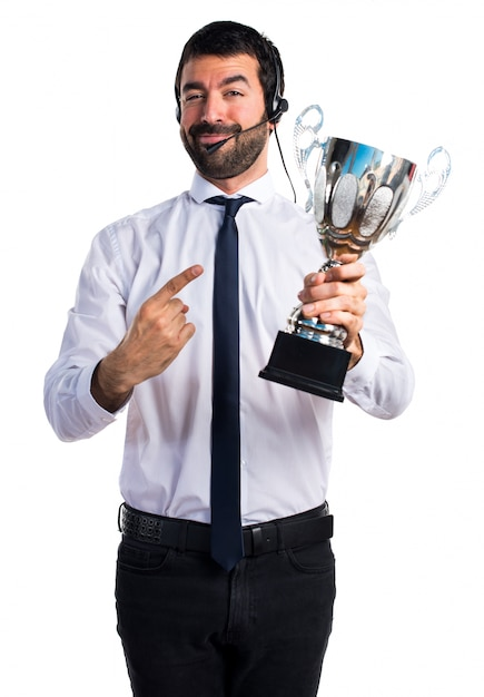 Handsome telemarketer man holding a trophy Free Photo