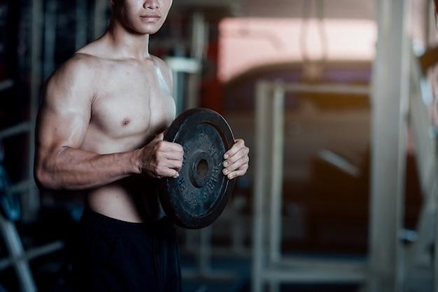 Handsome training equipment at sport gym Free Photo