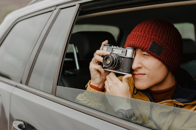 Handsome traveller taking photo close up Free Photo