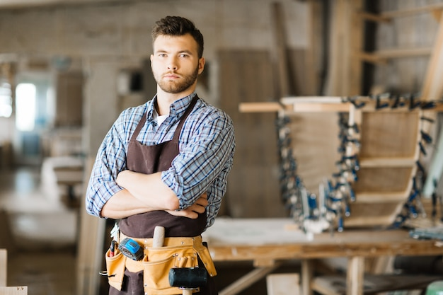 Handsome woodworker posing for photography Free Photo