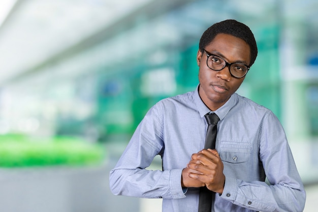 Handsome young african american man, showing off his physique in an aggressive pose Premium Photo