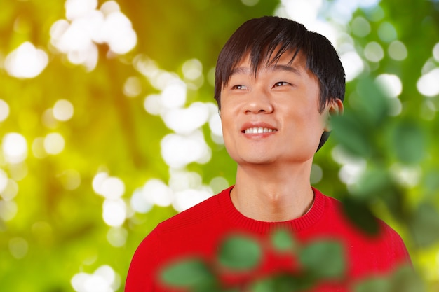 Handsome young asian man smiling Premium Photo