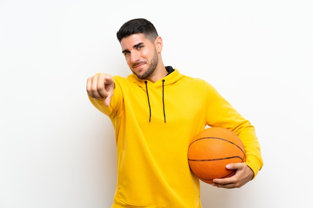 Handsome young basketball player man over isolated white wall points finger at you with a confident expression Premium Photo