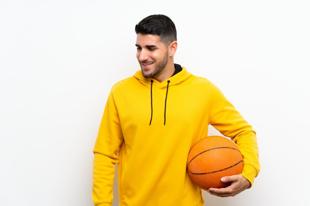 Handsome young basketball player man over isolated white wall smiling a lot Premium Photo