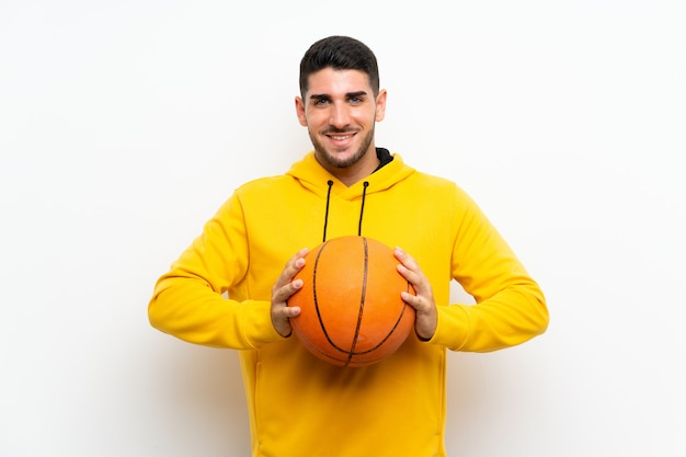 Handsome young basketball player man over isolated white wall Premium Photo